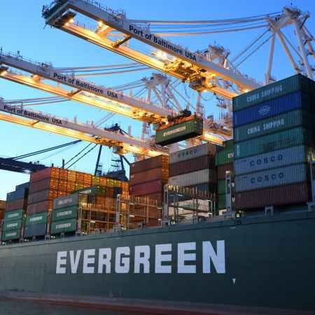 green and gray evergreen cargo ship